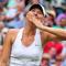 Maria Sharapova blows a kiss after beating German player Sabine Lisicki