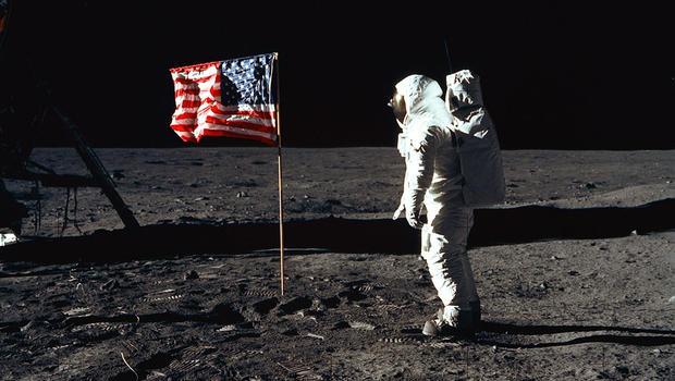 Buzz Aldrin moon landing with flag