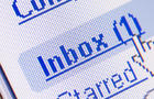 Monitor screen showing email in the inbox.