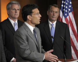 House Speaker John Boehner of Ohio, right, and House Majority Whip Kevin McCarthy of Calif., left, listen as House Majority Leader Eric Cantor of Va., center, speaks during a news conference on Capitol Hill in Washington, Thursday, July 28, 2011.