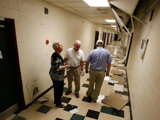 School officials survey the damage to Louis County High school after the 5.8 magnitude earthquake in Mineral, Va.  Aug. 23, 2011.