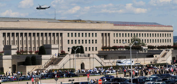 Civilians and military personnel evacuate the Pentagon in Washington after an earthquake was felt on  Aug. 23, 2011.
