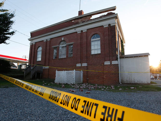 The sun sets behind a quake damaged building in Mineral, Va., a small town close to the epicenter,  Aug. 23, 2011.
