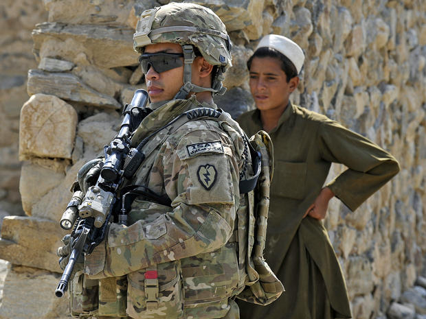 U.S. Army Sgt. Vu Nhon keeps watch Sept. 30, 2011, during a mission in the border-crossing town of Turkham Nangarhar, Afghanistan, near the border with Pakistan.