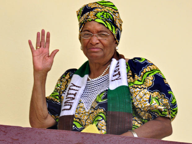 Liberian President Ellen Johnson Sirleaf waves at her home in the city of Monrovia, Liberia, Oct 7, 2011. Africa's first democratically elected female president, a Liberian campaigner against rape and a woman who stood up to Yemen's autocratic regime won the Nobel Peace Prize in recognition of the importance of women's rights in the spread of global peace. The 10 million kronor ($1.5 million) award was split three ways between Sirleaf, women's rights activist Leymah Gbowee also from Liberia and democracy activist Tawakkul Karman of Yemen, the first Arab woman to win the prize.