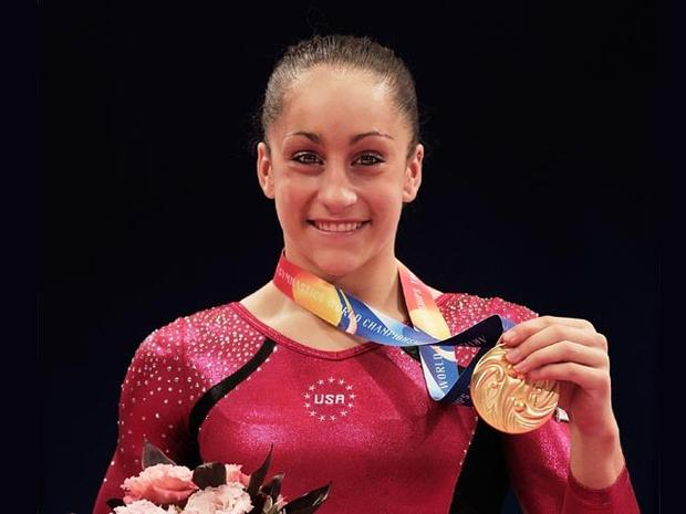 TOKYO, JAPAN - OCTOBER 13: Jordyn Weiber of the USA celebrates with her Gold Medal after victory in the Women's All Around Final during day seven of the Artistic Gymnastics World Championship Tokyo 2011 at Tokyo Metropolitan Gymnasium on October 13, 2011 in Tokyo, Japan. (Photo by Adam Pretty/Getty Images)