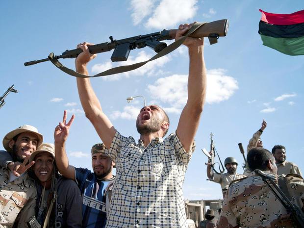 Libyan revolutionary fighters celebrate in Muammar Qaddafi's hometown of Sirte Oct. 20, 2011.