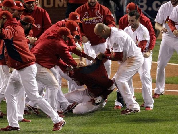 ST LOUIS, MO - OCTOBER 27: The St. Louis Cardinals bench rip the jersey shirt off of David Freese #23 after hitting a walk off solo home run in the 11th inning to win Game Six of the MLB World Series against the Texas Rangers at Busch Stadium on October 27, 2011 in St Louis, Missouri. The Cardinals won 10-9. (Photo by Rob Carr/Getty Images)