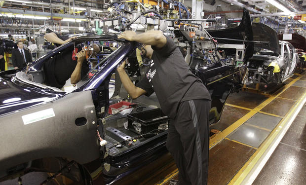 FILE - In this May 24, 2011 file photo, an assemblyman works on the line building Chrysler 200 vehicles at the Sterling Heights Assembly Plant in Sterling Heights, Mich. People briefed on the matter on Wednesday, Sept. 7, 2011 said Chrysler, Ford, and the United Auto Workers remain far apart in labor talks just a week before the current contract expires. Another person says General Motors has been talking pay for about two weeks and is closer to an agreement. (AP Photo/Carlos Osorio, File)