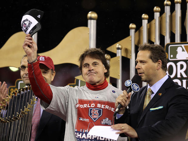 Tony La Russa celebrates with the World Series trophy