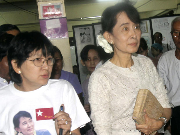 Myanmar democracy icon Aung San Suu Kyi, right, leaves her National League for Democracy (NLD) headquarters