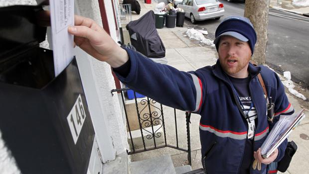 A USPS letter carrier delivers mail in Philadelphia