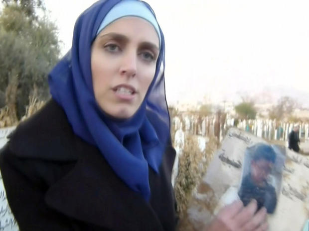CBS News correspondent Clarissa Ward shows a photograph handed to her by a man who claimed it is of a family member who was only 13-years-old when he was killed during the protests in Syria.