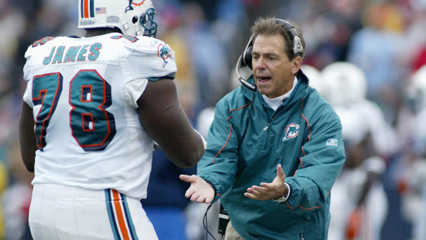 former dolphin says nick saban walked over convulsing player cbs news