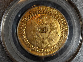 A rare 1787 gold Brasher doubloon, which sold for $7.4 million, one of the highest prices ever paid for a gold coin, is seen in New Orleans Dec. 9, 2011, in a photo provided by Blanchard and Company, Inc. Blanchard and Co., the New Orleans-based coin and precious metals company that brokered the deal, said the doubloon was purchased by a Wall Street investment firm.