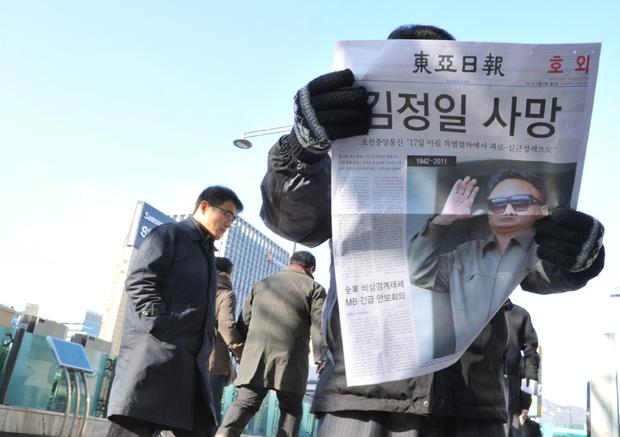 South Koreans read headlines about Kim Jong Il's passing