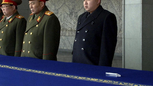 New North Korean leader Kim Jong Un, not in uniform, presides over a national memorial service for his late father, Kim Jong Il, at Kim Il Sung Square in Pyongyang, North Korea, Dec. 29, 2011. Ri Yong Ho, a vice marshal of the Korean People's Army, stands
