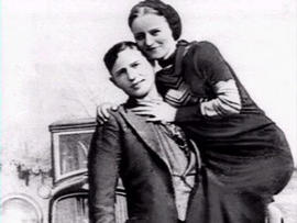 Notorious robbery partners Bonnie Parker and Clyde Barrow are seen in this picture taken between 1932 and 1934.