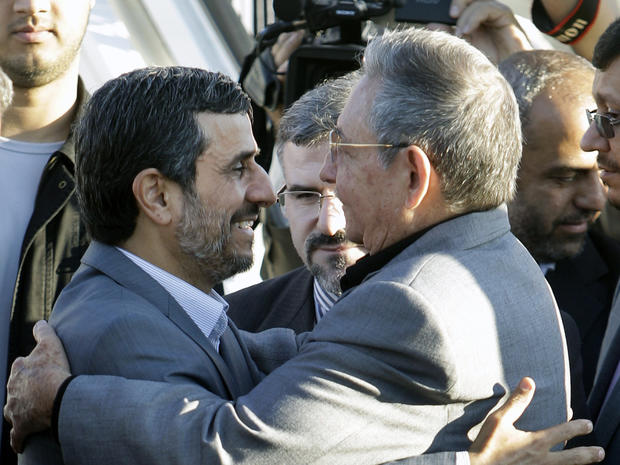 Raul Castro embraces Iran's President Mahmoud Ahmadinejad
