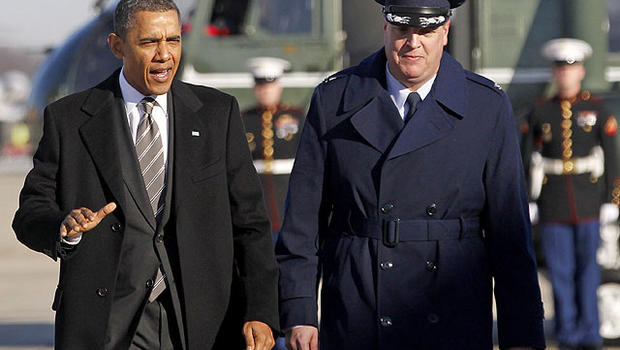 President Barack Obama walks toward Air Force One with Air Force Col. Dale S. Holland, vice commander of the 89th Airlift Wing, Jan. 19, 2012, at Andrews Air Force Base, Md.