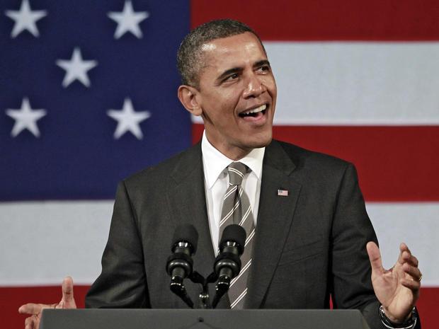 President Barack Obama sings before speaking