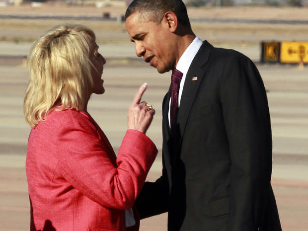 "Arizona Gov. Jan Brewer points during an intense conversation with President Barack Obama after he arrived at Phoenix-Mesa Gateway Airport, Wednesday, Jan. 25, 2012, in Mesa, Ariz. Asked moments later what the conversation was about, Brewer, a Republican, said: ""He was a little disturbed about my book."" Brewer recently published a book, ""Scorpions for Breakfast,"" something of a memoir of her years growing up and defends her signing of Arizona's controversial law cracking down on illegal immigrants, which Obama opposes. Obama was objecting to Brewer's description of a meeting he and Brewer had at the White House, where she described Obama as lecturing her."