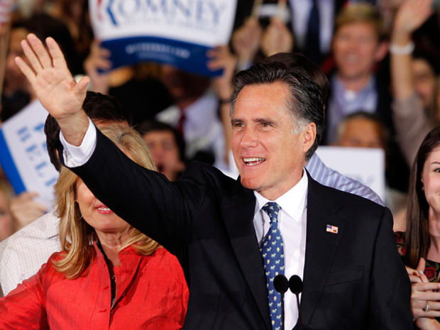 Republican presidential candidate, former Massachusetts Gov. Mitt Romney waves during his victory celebration after winning the Florida primary election Tuesday Jan. 31, 2012, in Tampa, Fla.