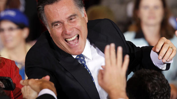 Former Massachusetts Gov. Mitt Romney greets supporters at his Florida primary night rally in Tampa, Fla., Jan. 31, 2012.
