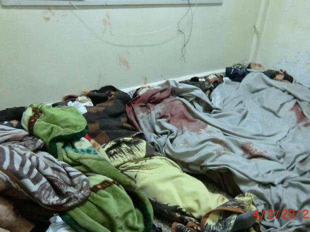 Alleged victims of a government massacre in Homs, Syria