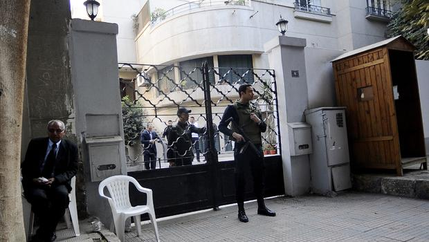 Egyptian soldiers stand guard in front of the U.S. National Democratic Institute