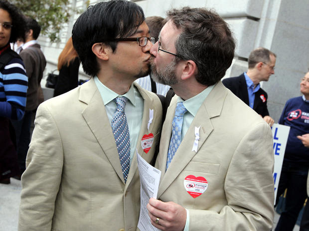 Same-sex couple Jeff Tabaco, left, and Thom Watson kiss as they hold paperwork for a marriage license Aug. 12, 2010, in San Francisco.