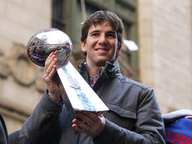 Eli Manning holds the Vince Lombardi Trophy