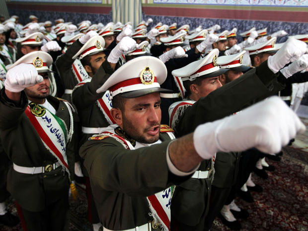 Iranian soldiers chant anti-Israeli and anti-U.S. slogans on the first day of celebrations marking the 33th anniversary of Ayatollah Ruhollah Khomeini's return from exile at Khomeini's mausoleum in Tehran, Iran, Feb. 1, 2012.