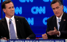 Romney, Santorum spar over auto bailout records
