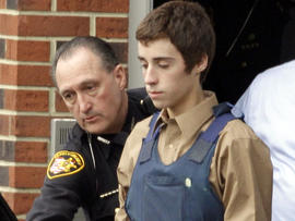 Seventeen-year-old TJ Lane is led from Juvenile Court by sheriff's deputies in Chardon, Ohio, Feb. 28, 2012, after his arraignment in the shooting of five high-school students.