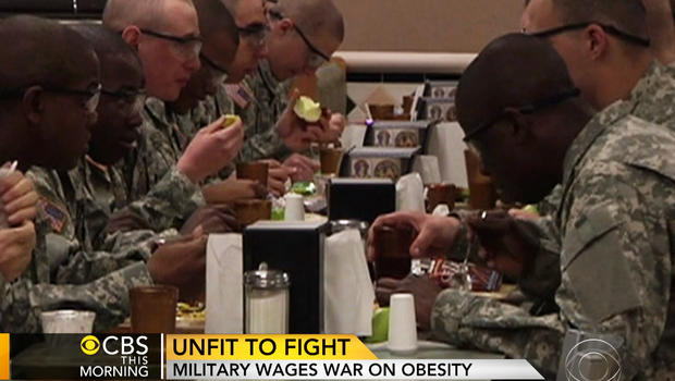 Soldiers eating in a dining hall