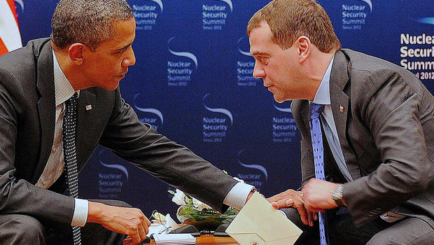 President Obama speaks to Russian President Dmitry Medvedev during a bilateral meeting in Seoul
