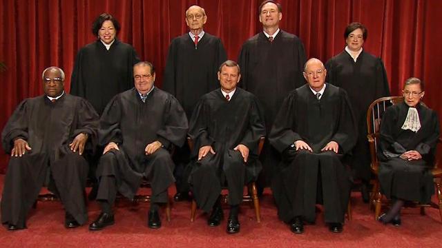 Supreme Court begins health care law arguments
