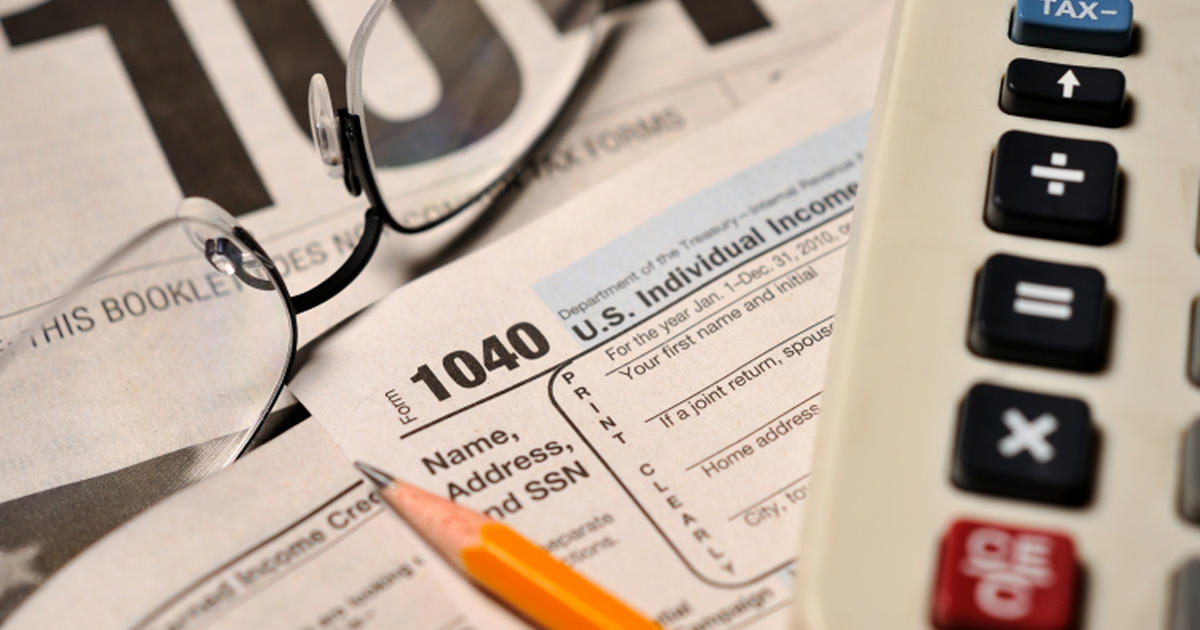 Taxing Times Behind The Form 1040 Cbs News