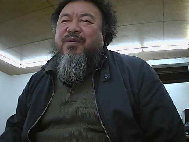 Ai Weiwei appears on a webcam in his home
