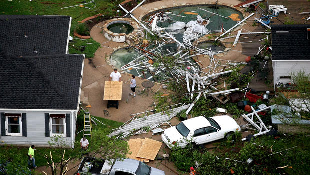 Residents clean up after a tornado hit in Arlington, Texas