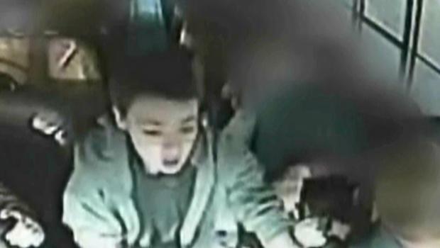 Kid takes wheel of a school bus