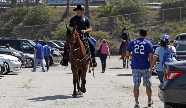 man beaten  dodger stadium parking lot  game  arrested cbs news