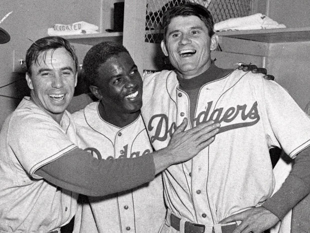 Brooklyn Dodgers from left, Pee Wee Reese, Jackie Robinson, and Preacher Roe are a happy trio