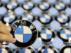 A worker holds up a logo of German carmaker BMW at the company's plant in the southern German city of Dingolfing on October 12, 2009. BMW constructs their 5, 6 and 7 series cars at the plant in Dingolfing. AFP PHOTO DDP / OLIVER LANG GERMANY OUT (Photo credit should read OLIVER LANG/AFP/Getty Images)