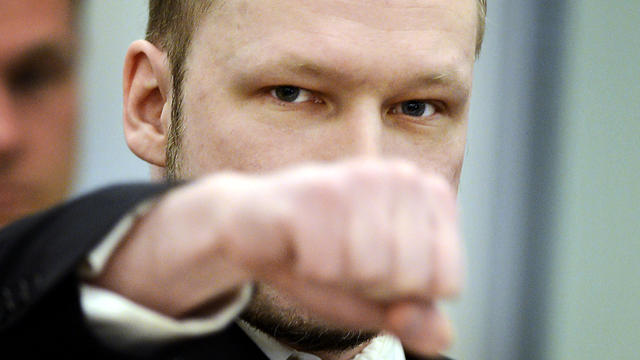 Right-wing extremist Anders Behring Breivik, who killed 77 people in twin attacks in Norway last year, makes a far-right salute as he enters an Oslo district courtroom at the opening of his trial April 16, 2012.