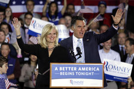 Mitt Romney, right, and wife Ann wave at an election night rally