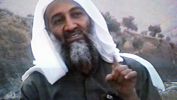 Osama bin Laden gestures in this frame grab from the Saudi-owned television network Middle East Broadcasting Center during the April 17, 2002, broadcast of an undated videotape.