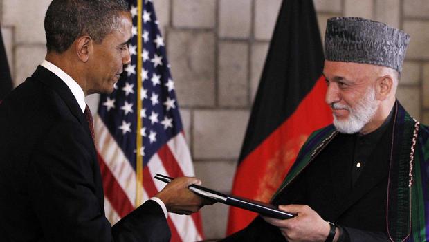 President Barack Obama and Afghan President Hamid Karzai sign a strategic partnership