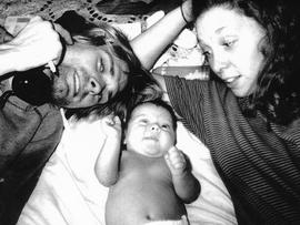 Kurt Cobain, his daughter Francis Bean Cobian, and Hole drummer Patty Schemel, in a photo taken while living together in 1992. (Photo by Courtney Love)